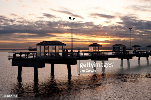 Silhouetted fishing pier elliott bay stock photo getty for Seattle fishing pier