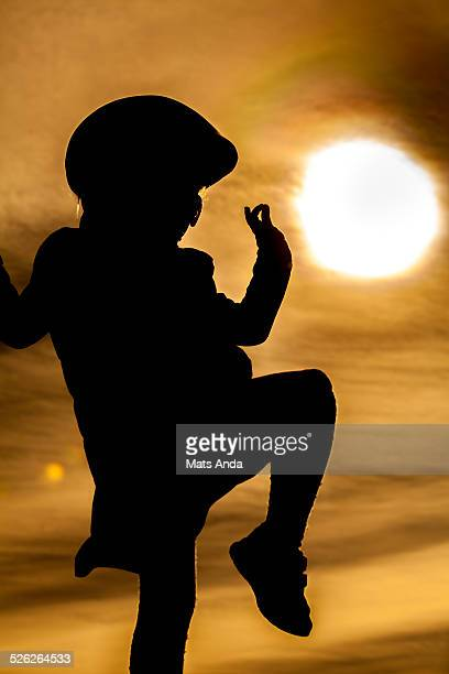 Silhouetted girl dancing in the sun
