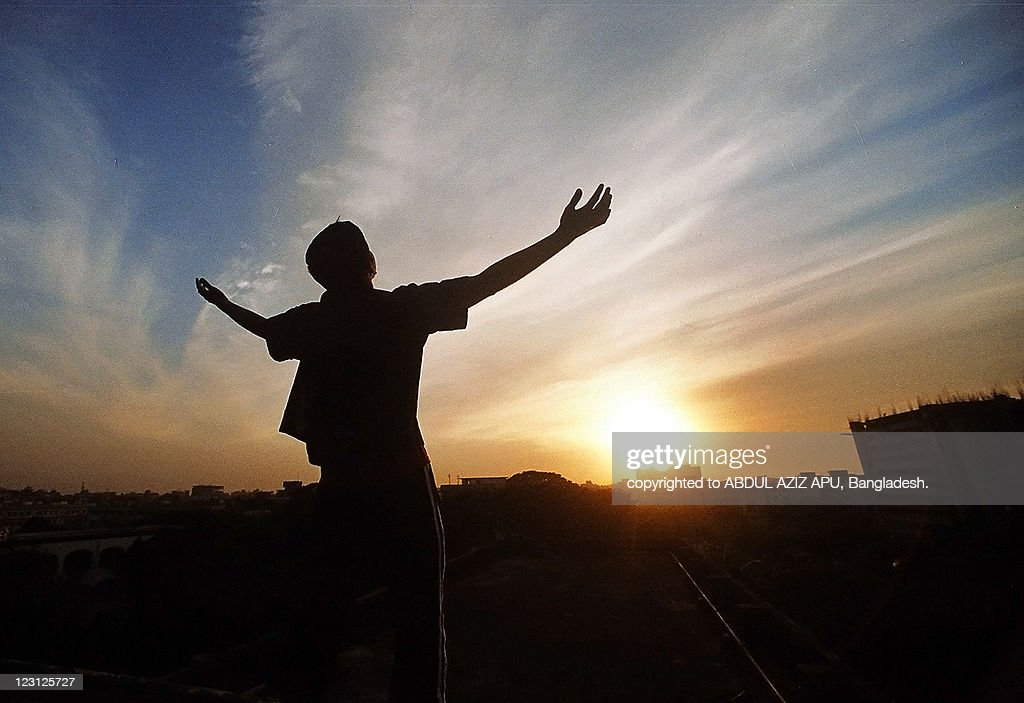 silhouetted image of man looking at sky : Stock Photo