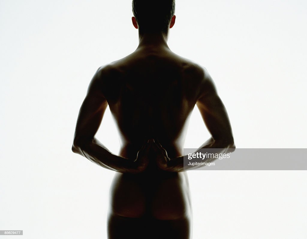 Silhouetted Man with Hands Behind Back : Stock Photo
