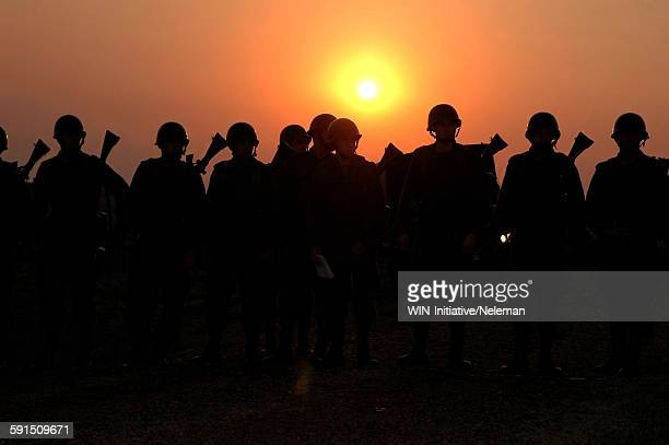 Silhouetted of soldiers marching