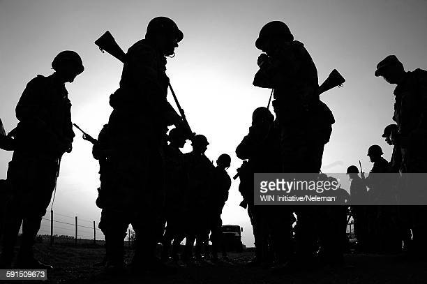Silhouetted of soldiers