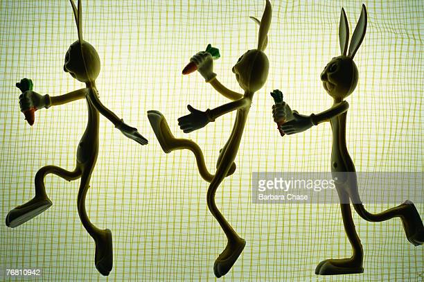 Silhouetted rabbit figures