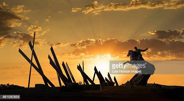 Silhouetted statue at sunset, Plaza de la Revolution, Santiago de Cuba, Cuba