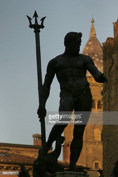 Silhouetted Statue Of Neptune
