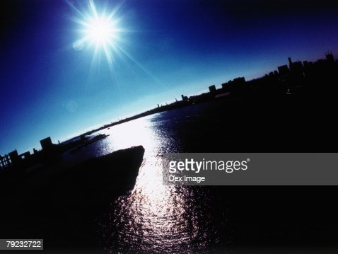 Silhouetted Tokyo Bay, Japan at sunset : Stock Photo