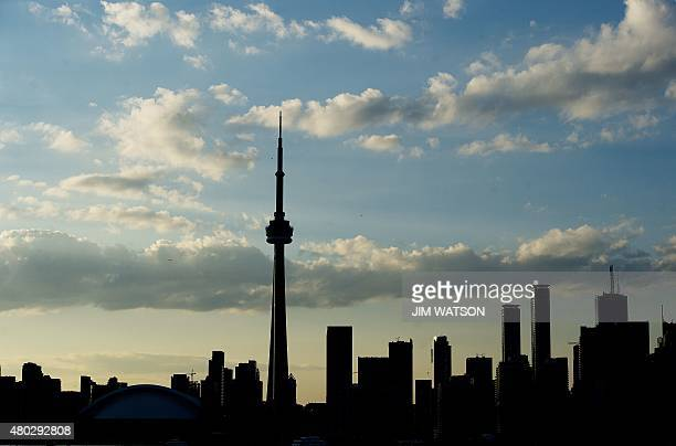 A silhouetted view of the skyline in Toronto Ontario on July 10 2015 AFP PHOTO/ JIM WATSON