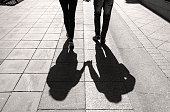 Silhouettes and Shadows of young Couple in a street Lovers walking in the City