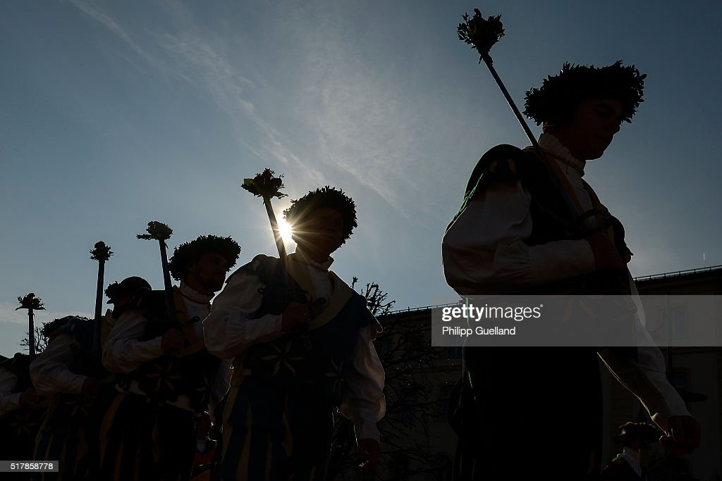 Silhouettes are seen of dancers dressed in traditional clothes perform the 'Schwertertanz' during the annual GeorgiRitt Easter Monday procession in...