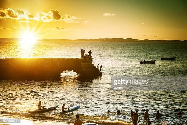 silhouettes at sundown over Barra Bay of Salvador da Bahia