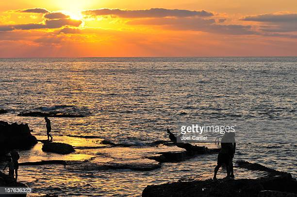 Silhouettes by the sea in Beirut Lebanon