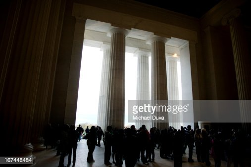 silhouettes inside the Lincoln memorial : Stock Photo