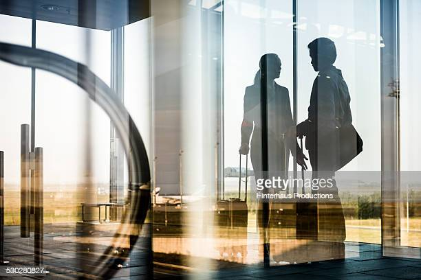 Silhouettes Of Business Travellers At Airport