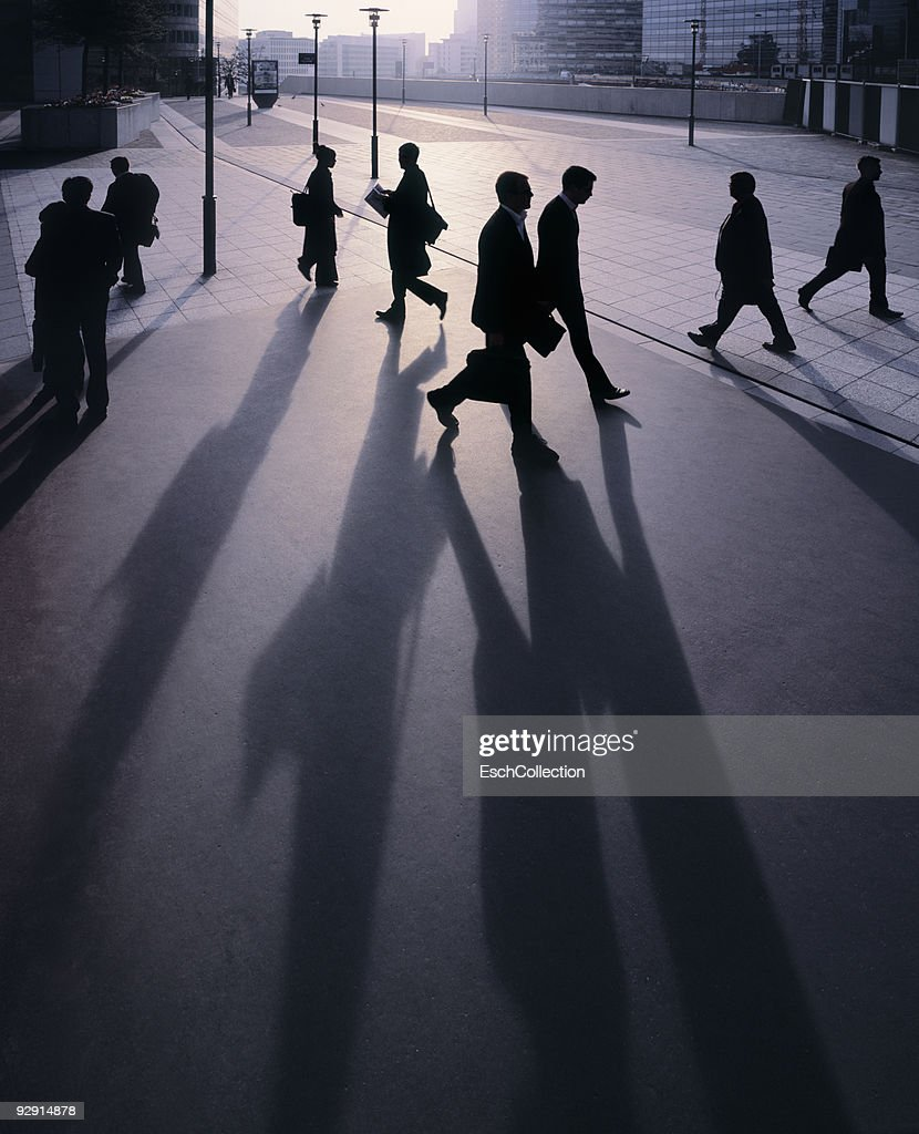 Silhouettes of businessmen going to work. : Stock Photo