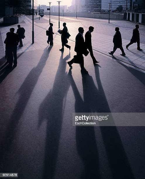 Silhouettes of businessmen going to work.