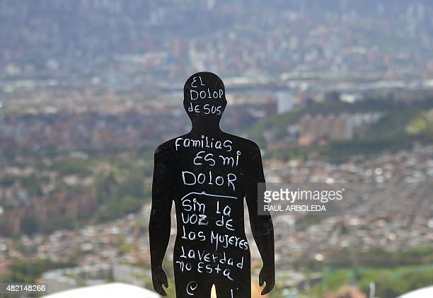 Silhouettes of missing people during a ceremony at 'La Escombrera' rubbish dump in the 13 Commune shantytown in Medellin Antioquia department...