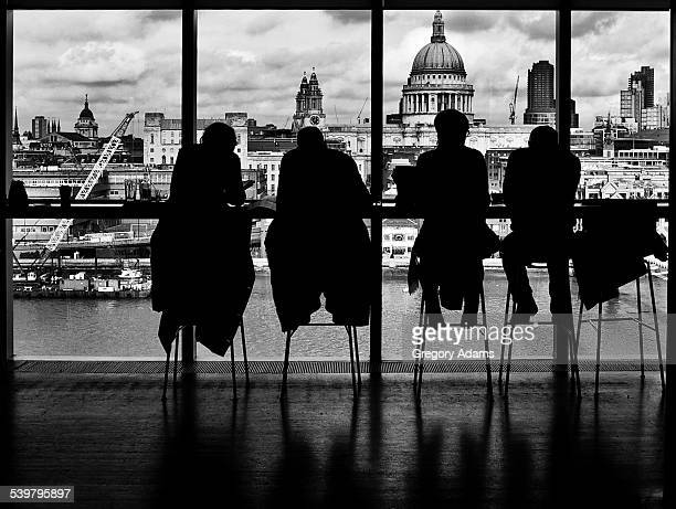 Silhouettes of people in a window in London