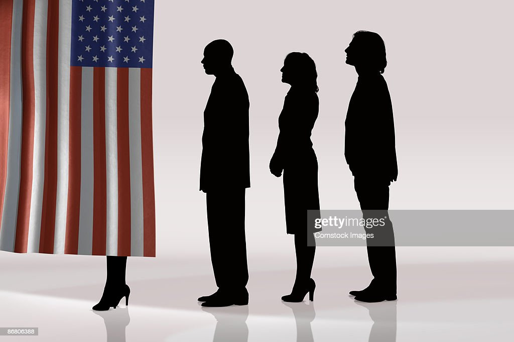 Silhouettes of people in line to vote