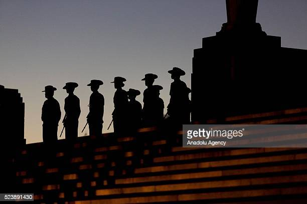 Silhouettes of soldiers are seen during the Anzac dawn service held at the Shrine of Remembrance on the 101st anniversary of the Australian and New...