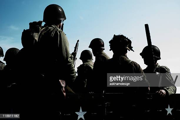 Silhouettes of soldiers going to war