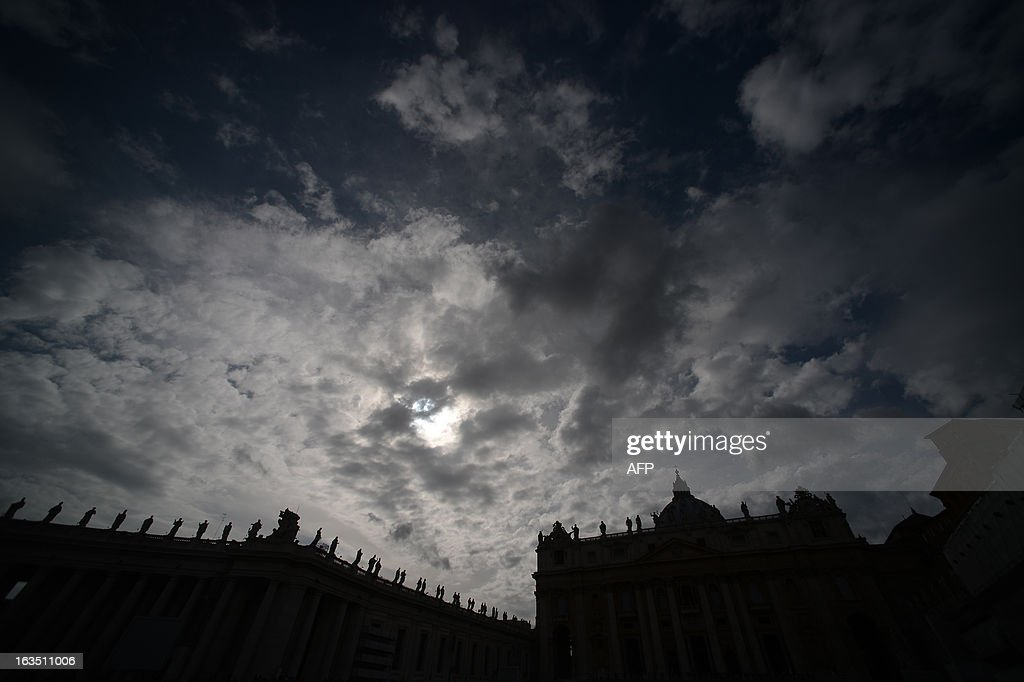 Silhouettes of statues on the colonnade at St Peter square ahead of the conclave on March 11, 2013 at the Vatican. Catholic cardinals had a final day of jockeying for position the same day before shutting themselves into the Sistine Chapel to elect a new pope after Benedict XVI's shock resignation, with an Italian and a Brazilian who both head powerful archdioceses among the top contenders. AFP PHOTO / FILIPPO MONTEFORTE