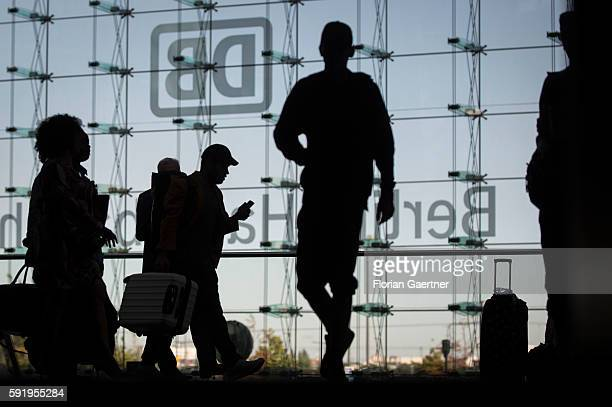 Silhouettes of traveler are captured on August 19 2016 in Berlin Germany