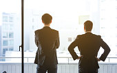 Silhouettes of two businessperson.