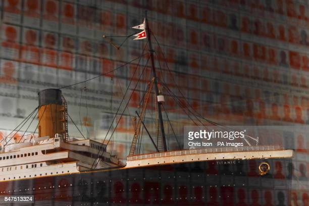 Silhouettes of victims of the Titanic disaster are reflected in the glass of a display case containing a scale model of the illfated White Star liner...