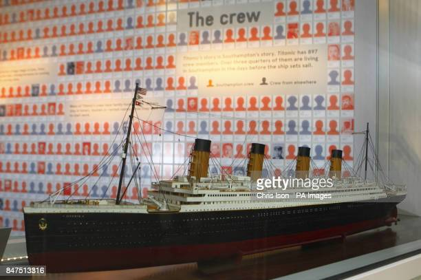Silhouettes of victims of the Titanic disaster are seen behind a display case containing a scale model of the illfated White Star liner at...