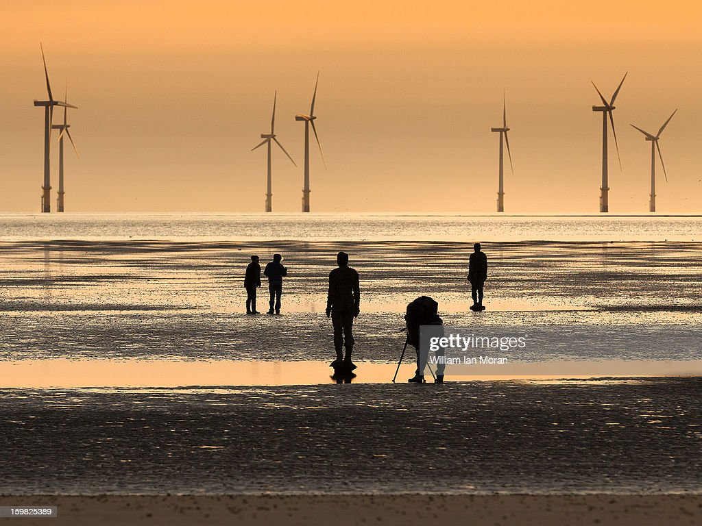 CONTENT] Silhouettes on Crosby beach, Artist Anthony Gormleys Another place ironmen with photographer and other figures in front of some of the 90MW wind farm at burbo bank, windturbines, each of which is around 260 feet tall.