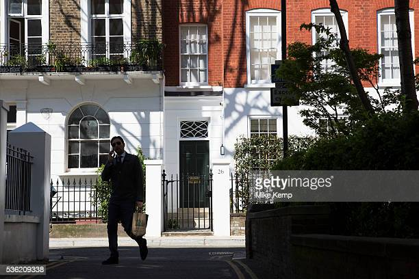 Silhouettes pass at the end of Kensington Church Walk In a selected few boroughs of West London wealth has changed over the last couple of decades...