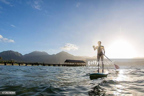 Silhoutte of Woman Paddle Boarding