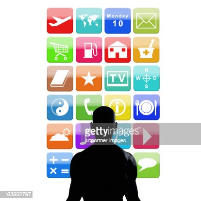 Silhoutte standing in front of Colorful Apps
