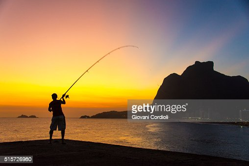 Silhuette of a fisher man in front a Gavea rock Rio de Janeiro, Brazil