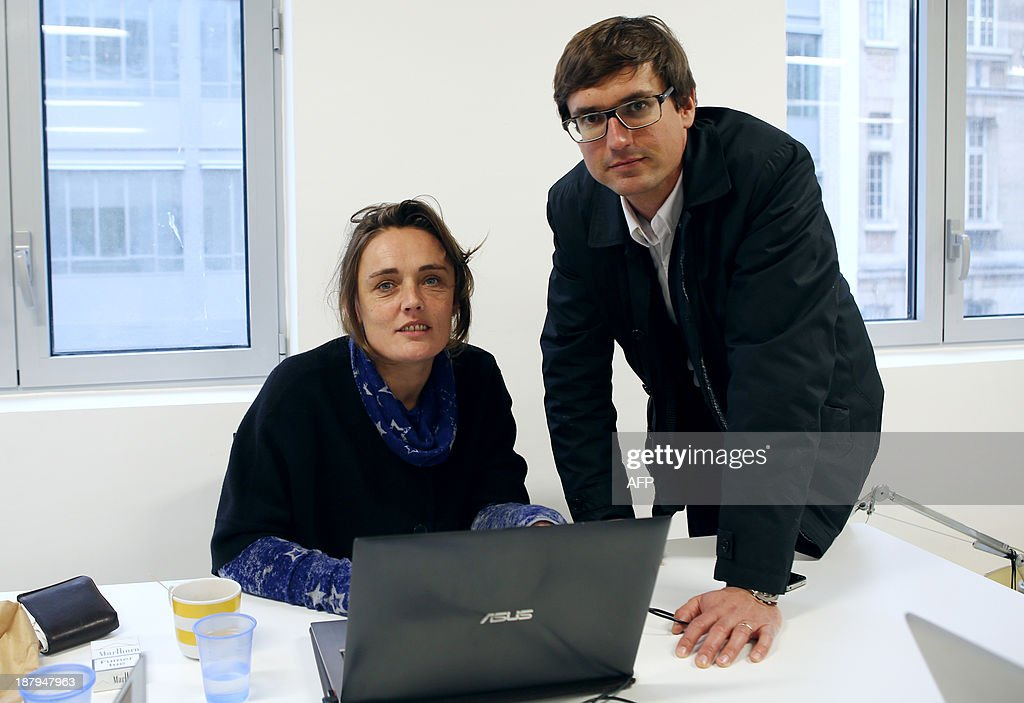 Silicon Sentier General Delegate Marie Vorgan Le Barzic, and president Adrien Schmidt pose at their office in the NUMA on November 12, 2013 in Paris. NUMA, an 'incubator' for French start-up companies and digital projects which opens on November 14, 2013, gathers investors, entrepreneurs, researchers and schools within a 1500-square metre facility. AFP PHOTO / Marion Ruszniewski