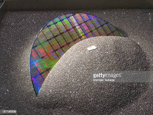A silicon wafer covered with black sand