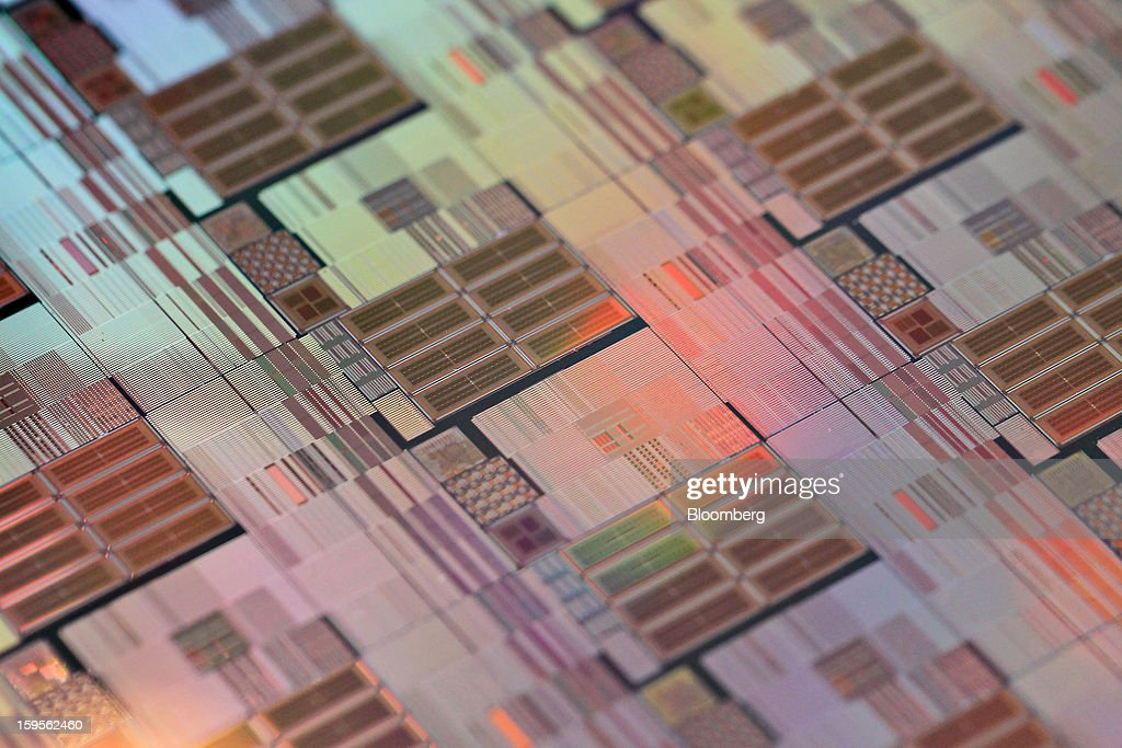 A silicon wafer made by Taiwan Semiconductor Manufacturing Co. (TSMC) is arranged for a photograph at the company's headquarters in Hsinchu, Taiwan, on Wednesday, Jan. 16, 2013. Taiwan Semiconductor Manufacturing Co., the world's largest supplier of made-to-order chips, is scheduled to announce company results tomorrow. Photographer: Maurice Tsai/Bloomberg via Getty Images