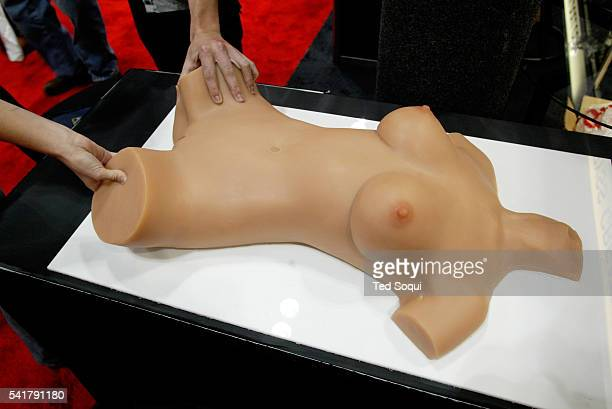 A silicone sex doll is handled by attendees at the 2003 Erotica Los Angeles convention held at the LA Convention Center