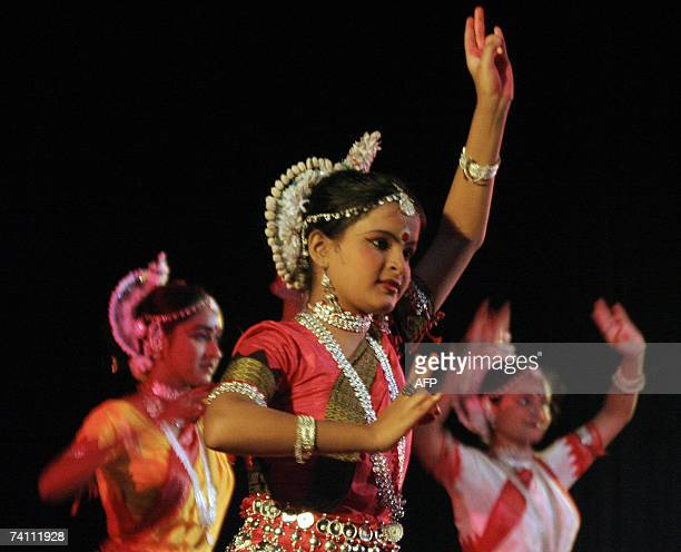 Indian dancers in traditional attire perform a cultural dance at an event in Siliguri 09 May 2007 held to celebrate the 146th birth anniversary of...
