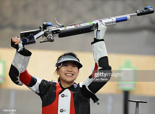 Siling Yi of China celebrates as she wins the gold medal during the Women's 10m Air Rifle Shooting Final on Day 1 of the London 2012 Olympic Games at...