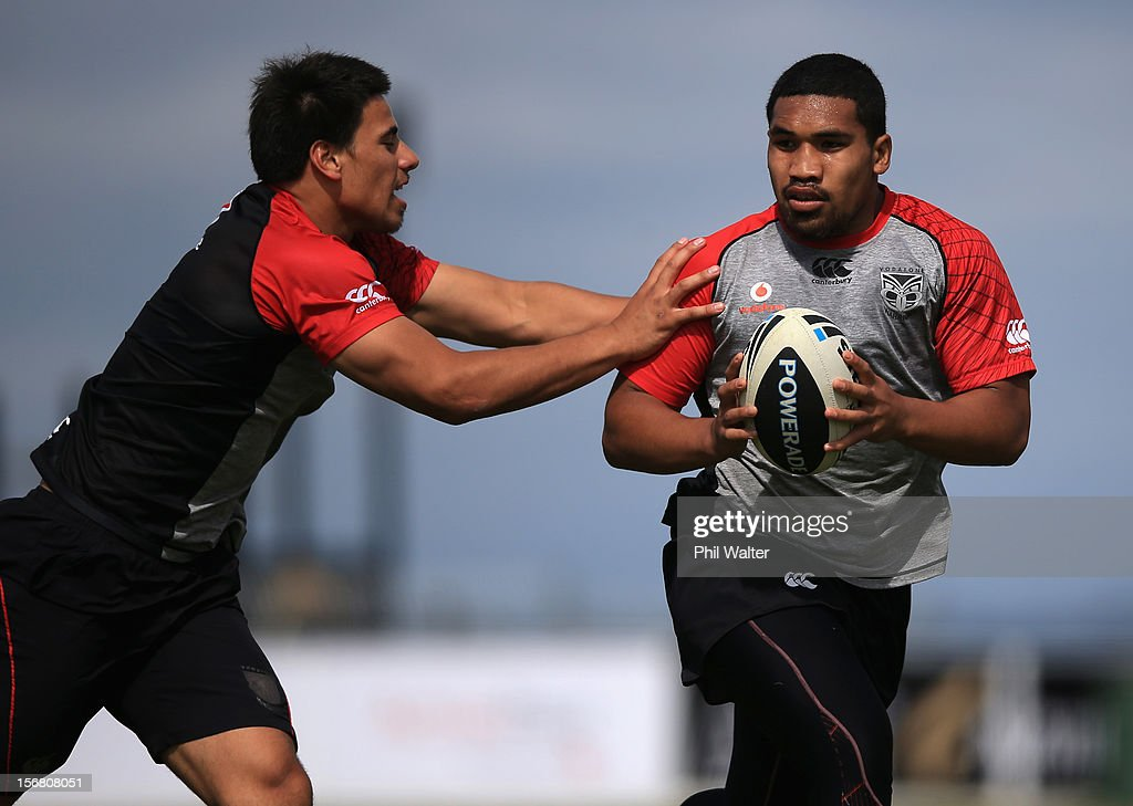 Siliva Havili of the Warriors (R) is tackled during a New Zealand Warriors NRL pre-season training session at the Millenium Institute on November 22, 2012 in Auckland, New Zealand.