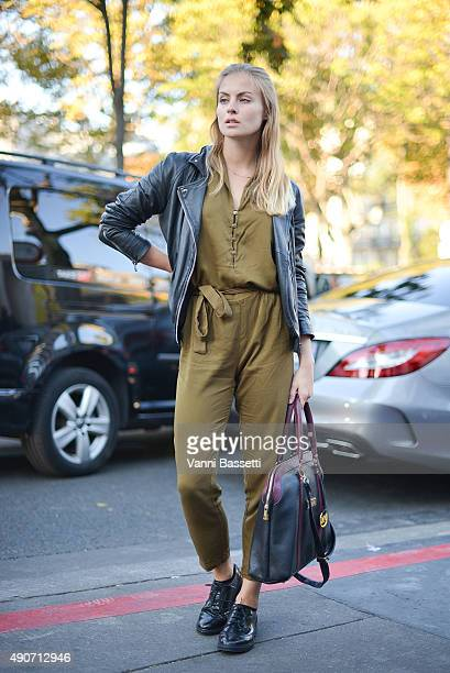 Silja Stuven poses wearing a Forever 21 overall Asos jacket and Michael Kors bag before the Rochas show at the Palais de Tokyo during Paris Fashion...