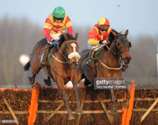 Silk Affair ridden by T J O'Brien leads over the last fence from Gouranga ridden by Mattie Batchelor in the ggcom Mares Maiden Hurdle Race
