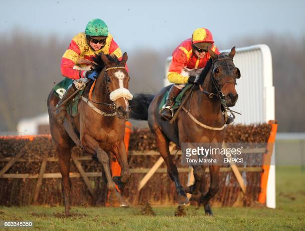 Silk Affair ridden by T J OBrien leads over the last fence from Gouranga ridden by Mattie Batchelor in the ggcom Mares Maiden Hurdle Race