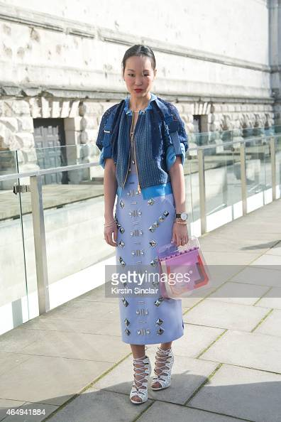 Silk and Suits fashion blogger Mariko Kuo wears a Three Floor jacket and dress Joanne Stoker bag and Public Desire shoes on February 24 2015 in...