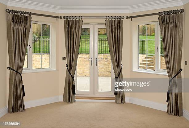 silk curtains and bay windows