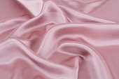 Pink silk fabric for background.
