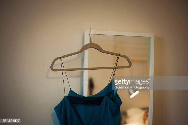 Silk nightgown hanging from a mirror