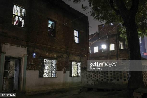 A silk saree workshop stands illuminated at night in Varanasi Uttar Pradesh India on Friday Oct 27 2017 In Varanasi where the manufacture of 45meter...