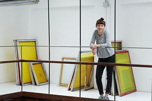 Silk screen worker at her studio